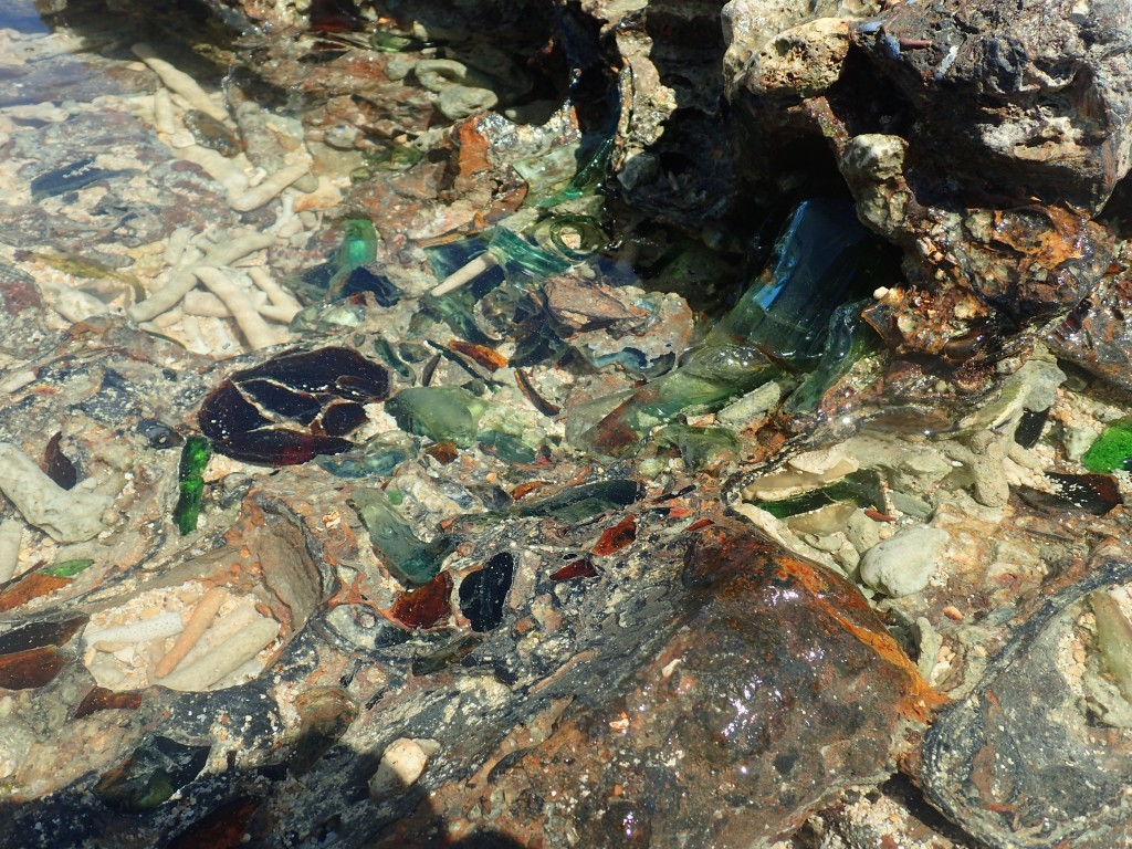 Glass and crockery debris solidified on the beach